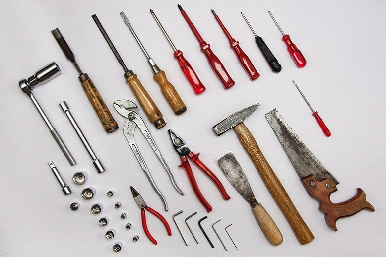 Hand tools for the title 'Choosing the Perfect Theme for Your WordPress Site'